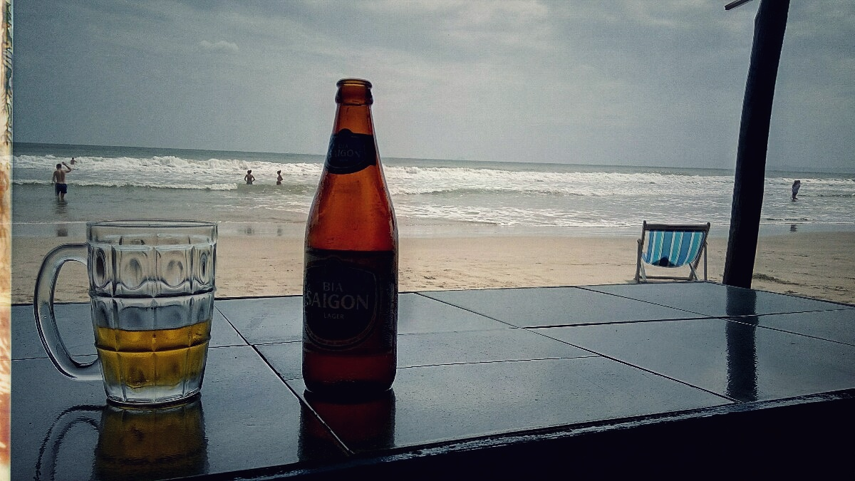 Videonauts backpacking Vietnam beer on the beach