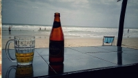 Videonauts backpacking Vietnam beer on the beach